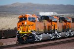 BNSF 6888, BNSF 6885, and BNSF 6887 close in shot as they head west.